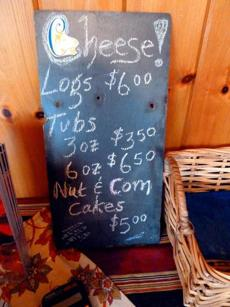 At Crystal Brook Farm, a slate states prices and items for sale.